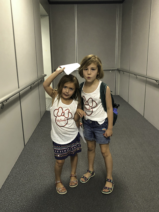 Girls walking onto the airplane for Hawaii.
