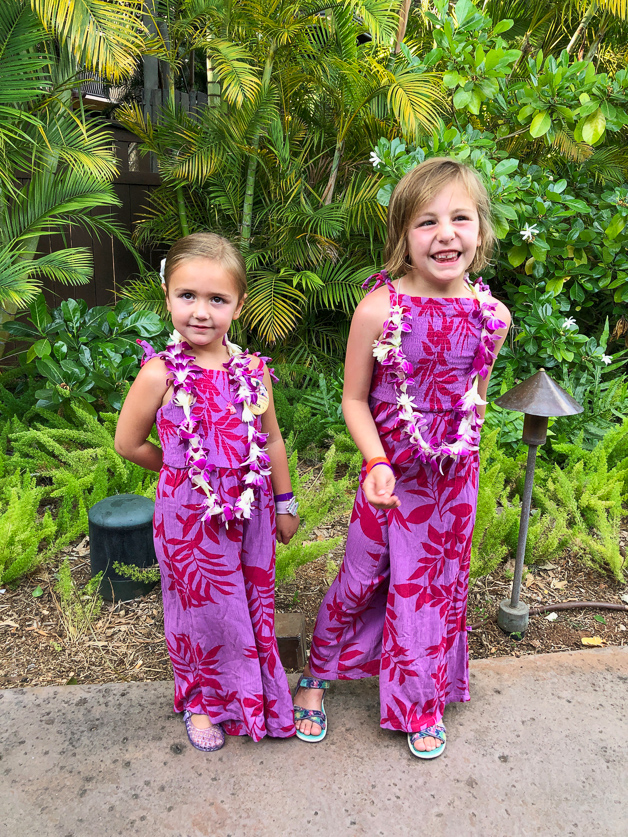 2 girls with leis getting ready for la'ue - best moment at Disney Aulani.