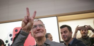 Apple CEO Tim Cook says he's taking on climate change and needs backup
