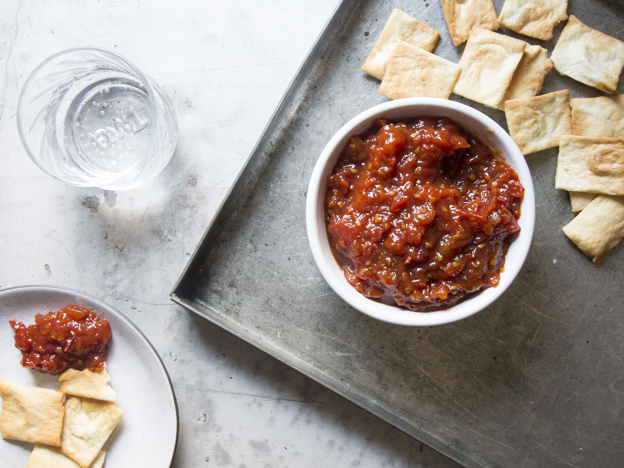 "Your glut of garden tomatoes just found their new home: stirred into caramelized honey and a host of herbs and spices. Get the recipe for <a href=""https://www.saveur.com/summer-tomato-and-herb-dip-recipe/"">Summer Tomato and Herb Dip</a>"