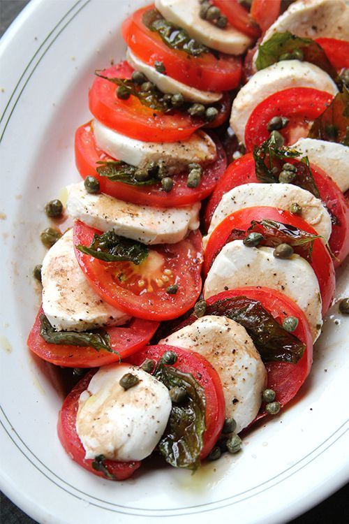 "Briny and slightly crispy fried capers punch up the flavor of this classic Italian tomato and mozzarella salad. Get the recipe for <a href=""https://www.saveur.com/article/recipes/caprese-salad-with-fried-capers-and-basil/"">Caprese Salad with Fried Capers and Basil</a>"