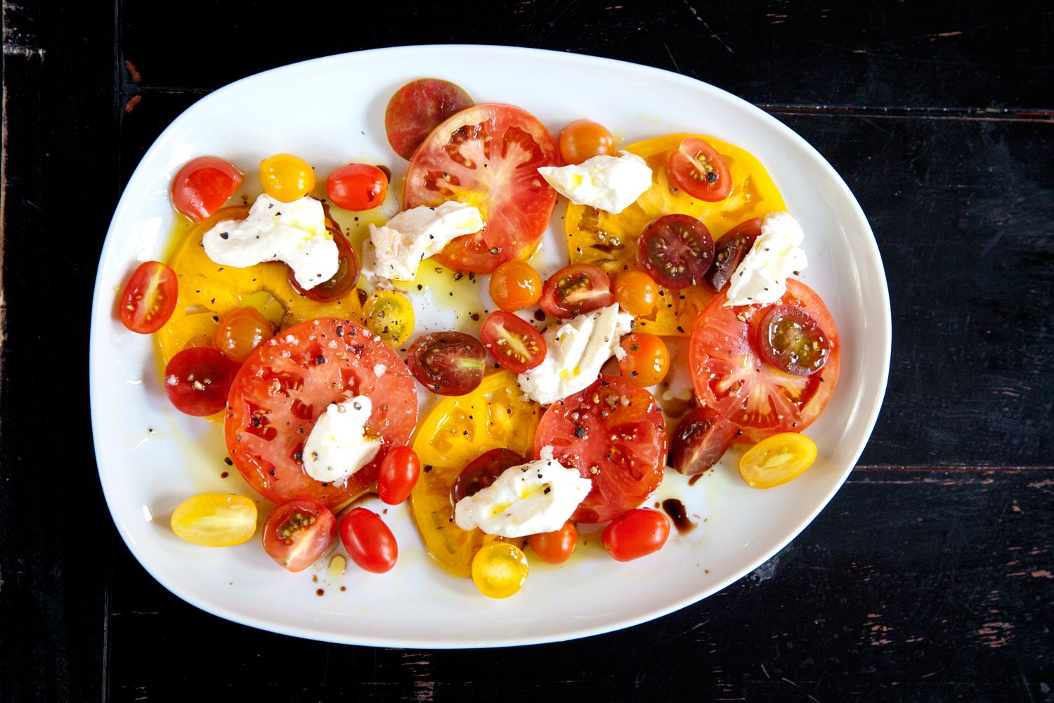 "A dish as simple as caprese salad demands the best ingredients: Use firm, in-season tomatoes, the freshest burrata, and dress with pristine olive oil and top-quality balsamic vinegar. Get the recipe for <a href=""https://www.saveur.com/article/Recipes/Classic-Caprese-Salad/"">Caprese Salad</a>"