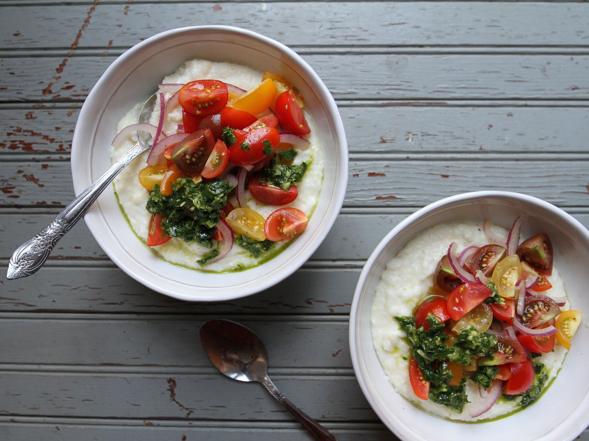 "Chimichurri and a tomato-onion salad are perfect for offsetting the richness of creamy polenta. Get the recipe for <a href=""http://www.saveur.com/summer-polenta-recipe"">Summer Polenta with Chimichurri and Tomatoes</a>"
