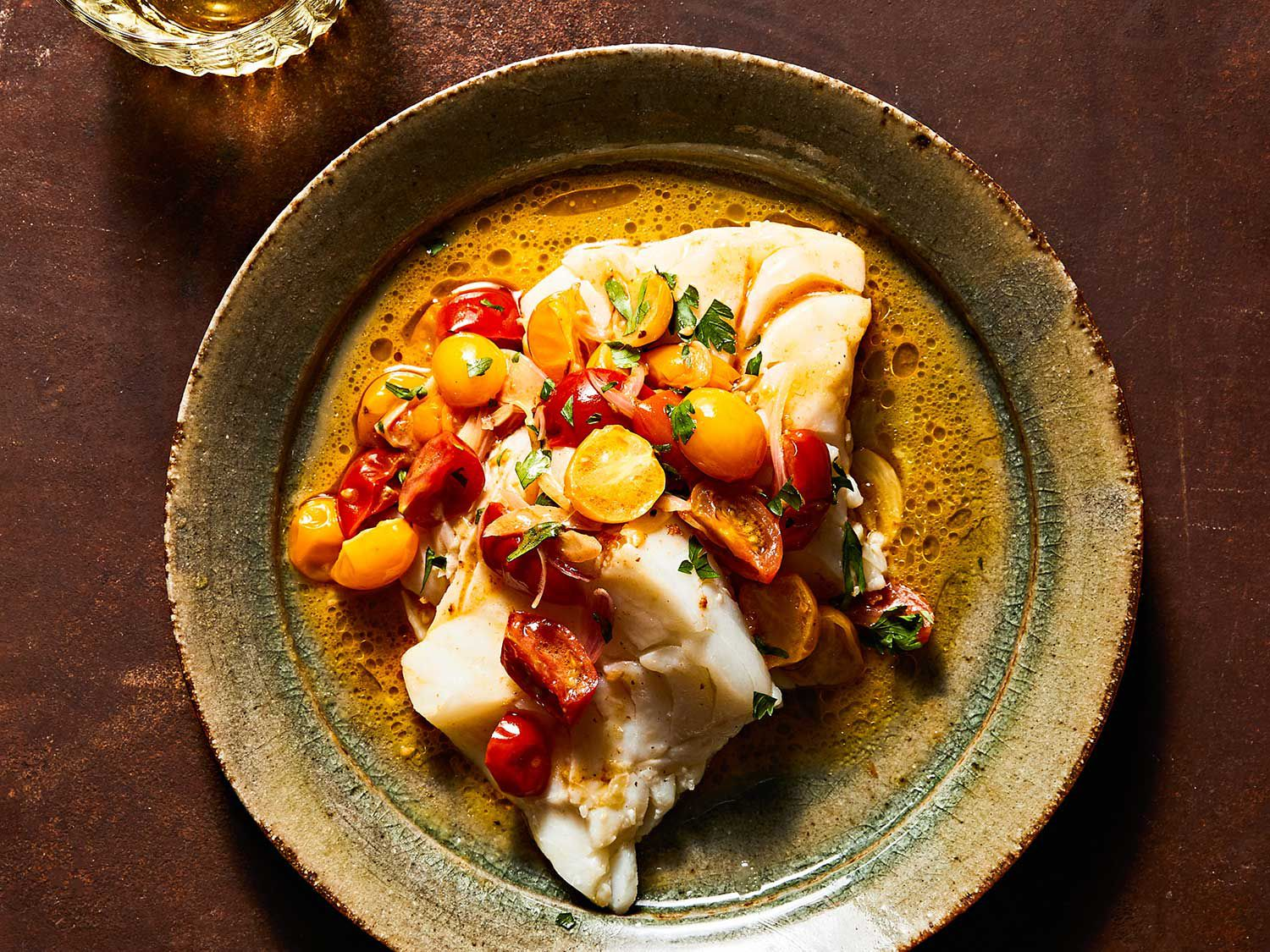 "Brown butter, or what the French call beurre <em>noisette</em>, is enhanced with summer tomatoes and a splash of vermouth for the superlative sauce in this weeknight fish dish. Get the recipe for<a href=""https://www.saveur.com/skillet-cod-with-brown-butter-tomato-sauce-recipe/"">Skillet Cod with Brown-Butter Tomato Sauce</a>"
