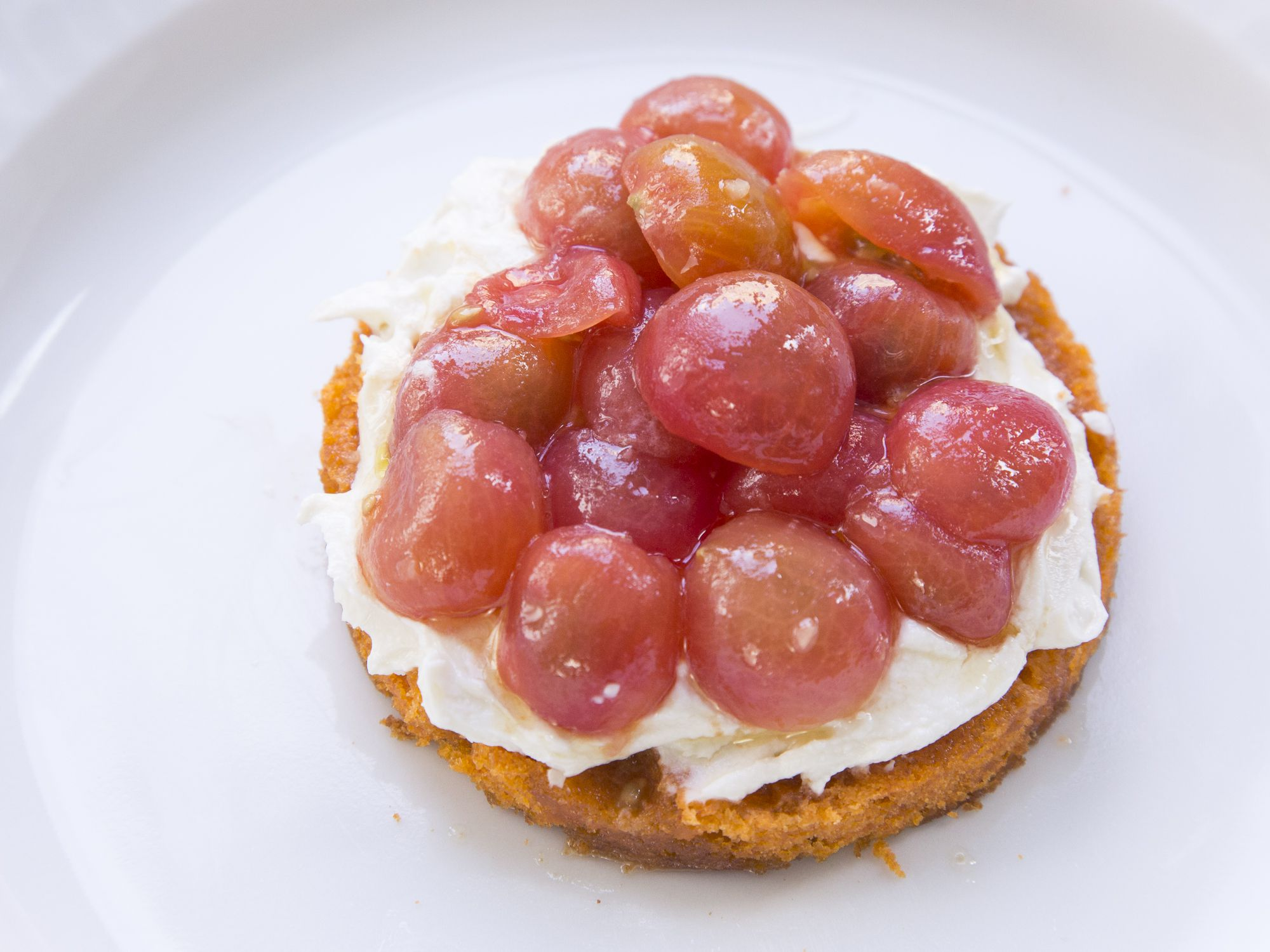 "In this recipe from Amanda Cohen, chef-owner of New York City's <a href=""http://www.dirtcandynyc.com/"">Dirt Candy</a>, tomato powder lends flavor to this savory-sweet cake, which gets topped with smoked feta cream and cherry tomato halves. Get the recipe for <a href=""https://www.saveur.com/tomato-cake-feta-recipe/"">Tomato Cake with Smoked Feta Cream and Marinated Tomatoes</a>"
