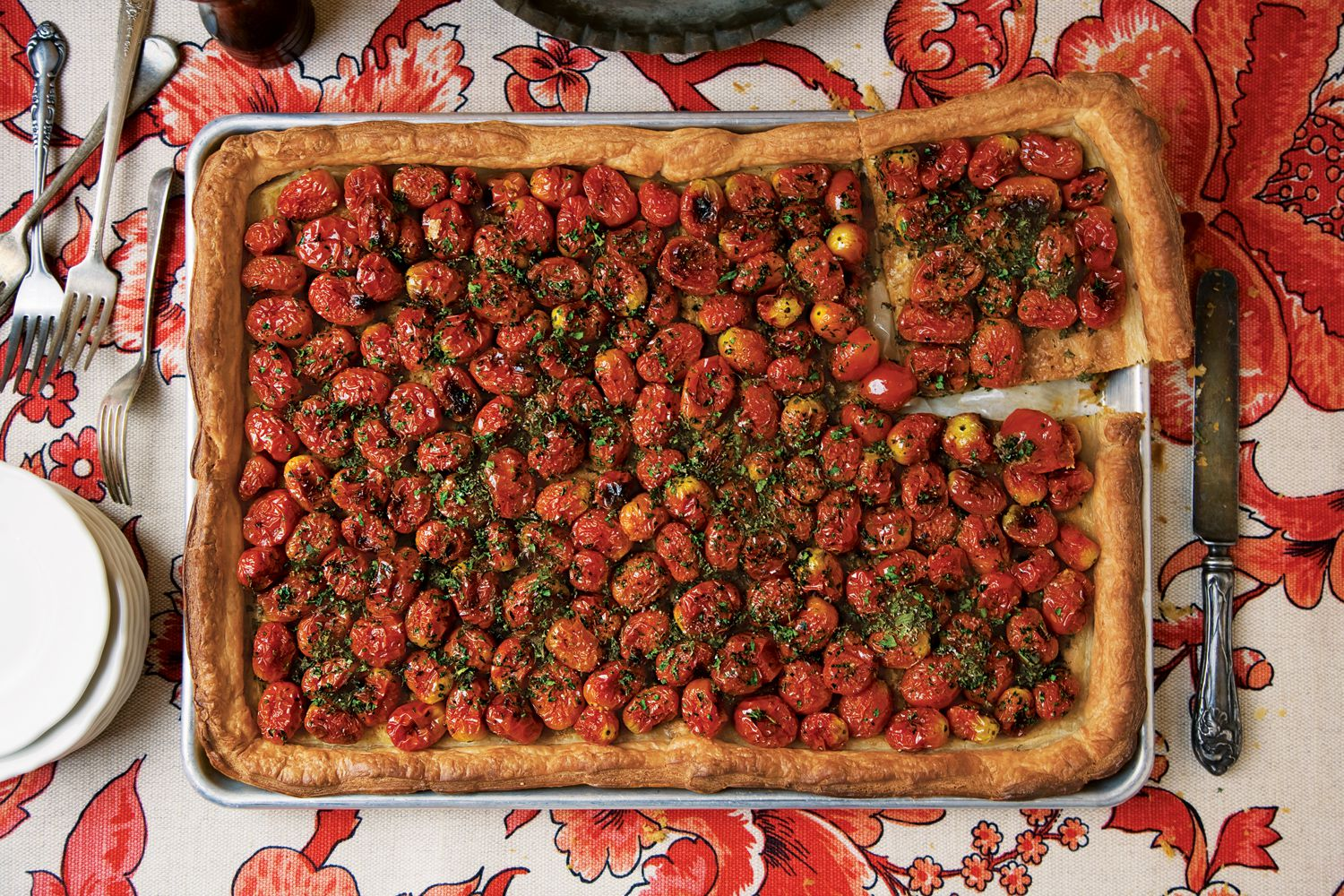 "Made with ripe cherry tomatoes and fragrant herbs, this tart is both delicious and beautiful. Get the recipe for <a href=""https://www.saveur.com/article/Recipes/Herbed-Tomato-Tart/"">Herbed Tomato Tart</a>"