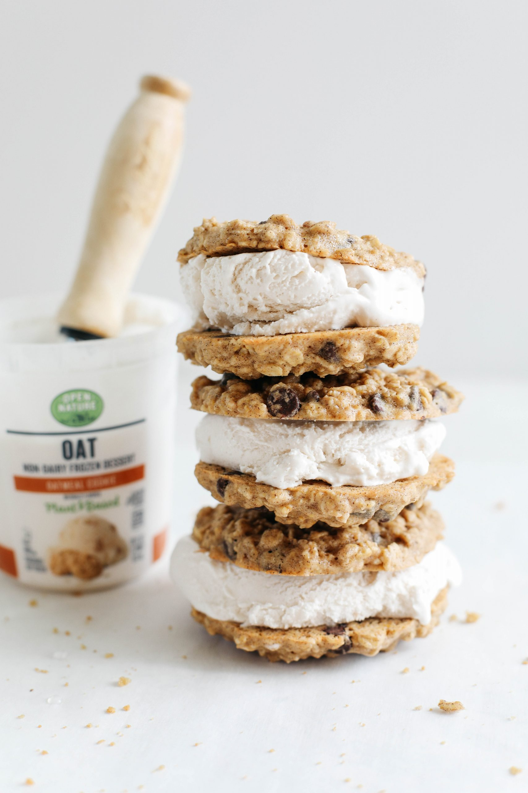 Celebrate the summer with these homemade oatmeal chocolate chip cookie ice cream sandwiches that are dairy-free, vegan and taste just like your childhood!