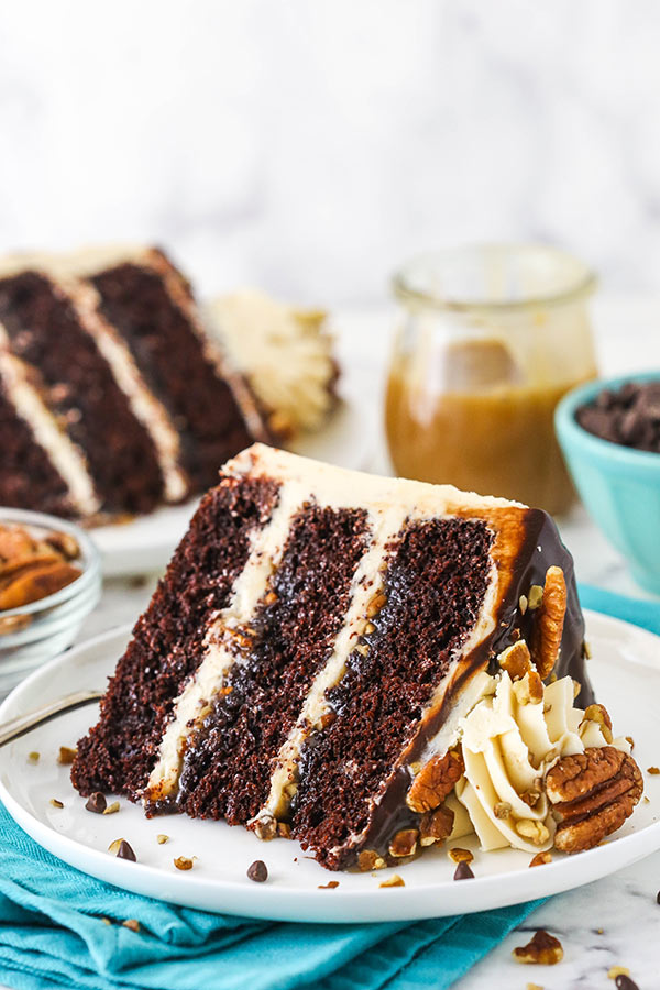 slice of cake with jar of caramel in background