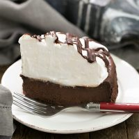 Flourless Chocolate Cake with Marshmallow Frosting - a dense dreamy chocolate cake topped with a mound of sweet, fluffy marshmallow frosting!